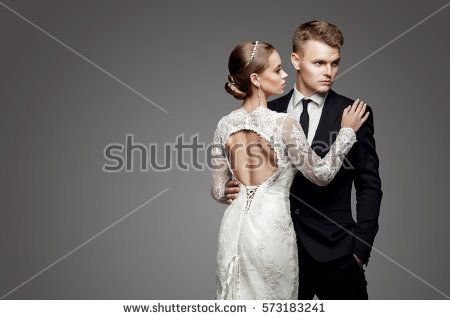 Groom in yellow bow tie with bride, studio