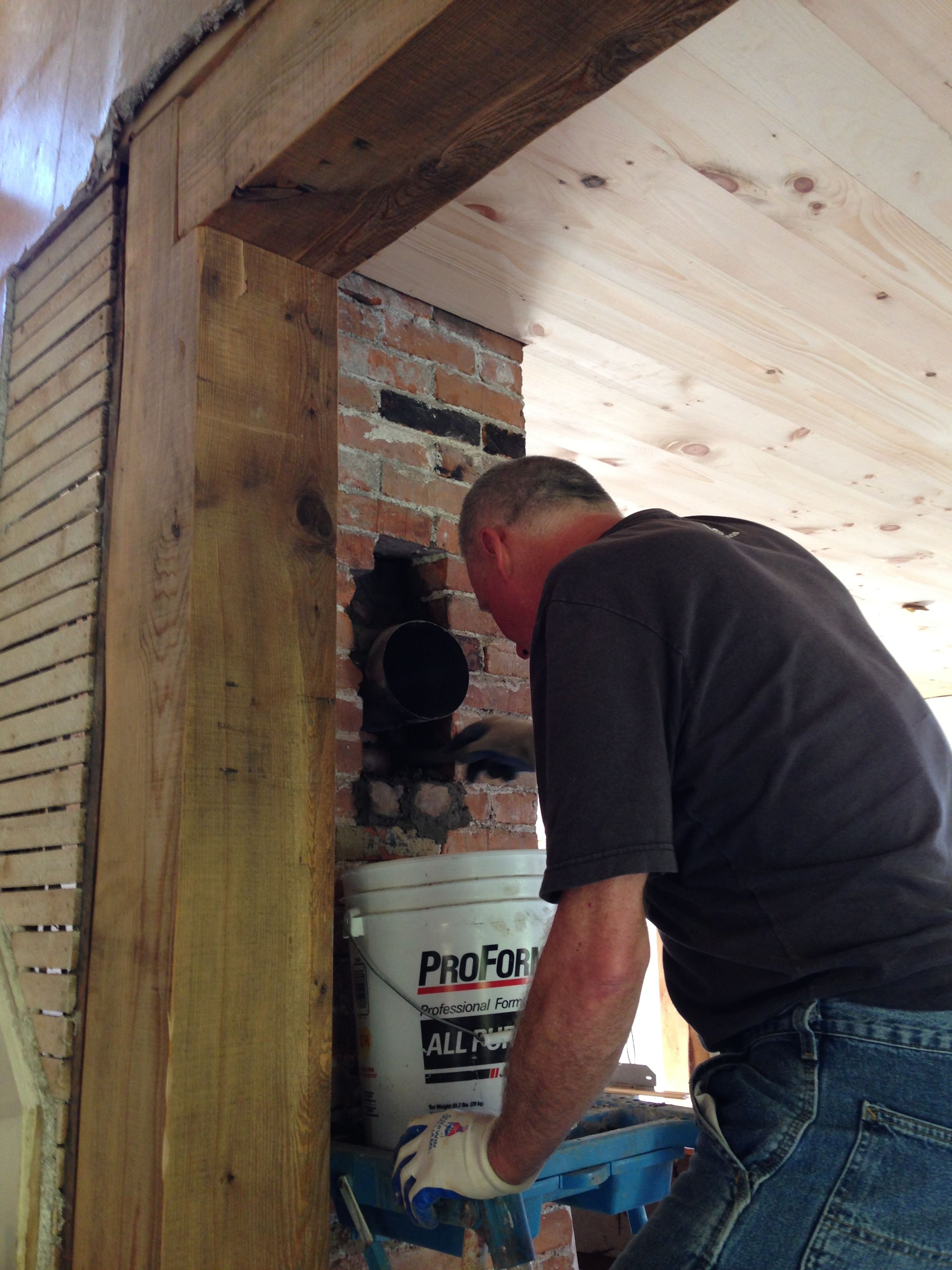 The Husband Fitting, Patching The Kitchen Connection For The Wood Stove.  That Post And