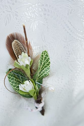 What about a variety of feathers in the boutonnière?