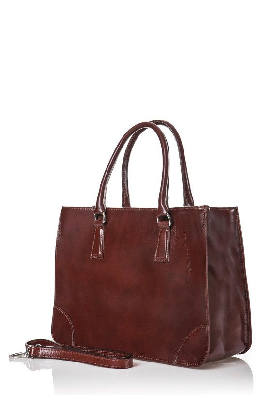Awesome genuine calfskin tote bag.  With 2 handles and coming with a shoulder strap.  Inside: 1 large pocket with zip,  dividing 2 sections, a small pocket with zip and a pocket for smartphone.  Size L x H x D (cms) : 36 x 26 x 18