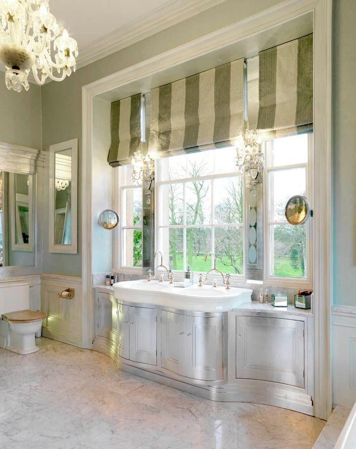 Bathroom in white Carrara Marble and silver leaf