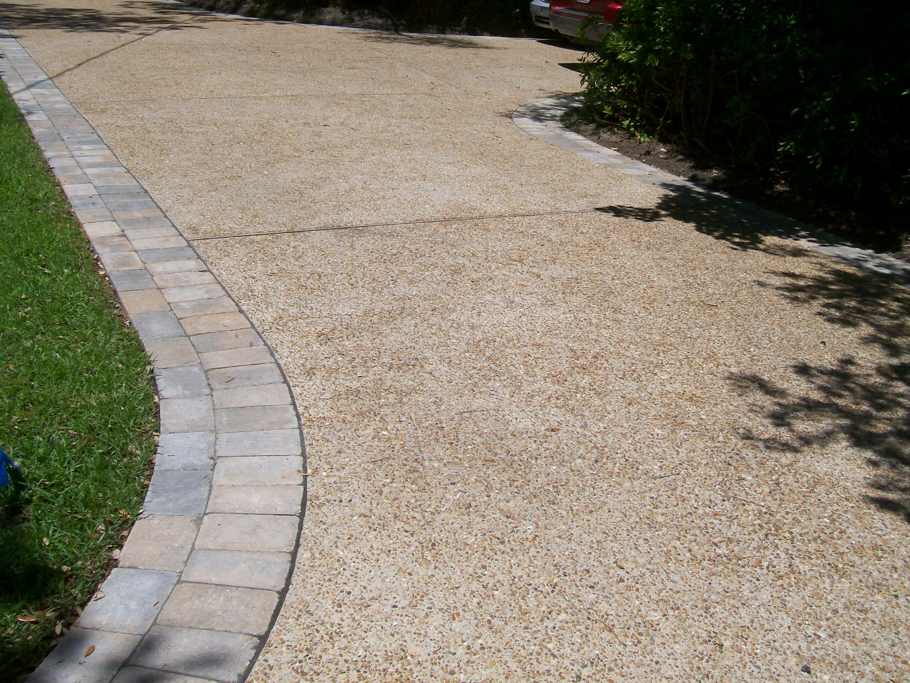 Exposed aggregate driveway with paver border google for Cement driveway ideas