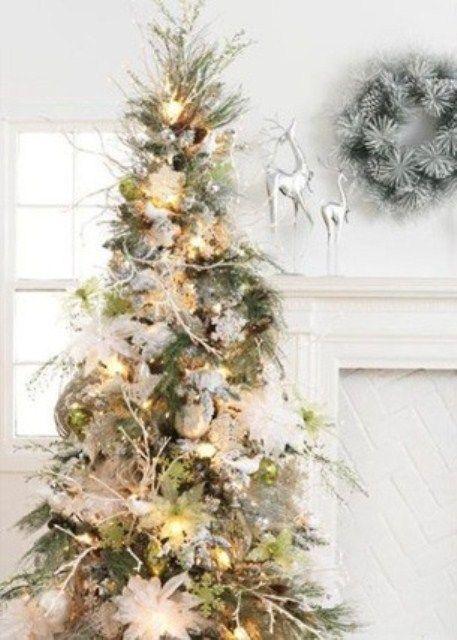 Elegant Christmas tree with white poinsettias and silver tree twigs