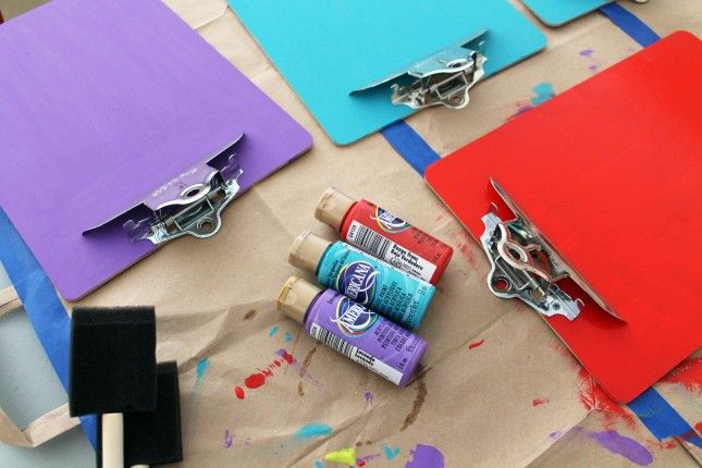 Painting our clipboards to create a colorful clipboard pinboard. :)