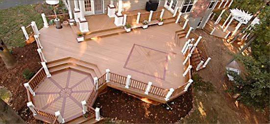 custom designs in your decks can add a feeling of separate rooms to your larger deck - Patio Deck Design