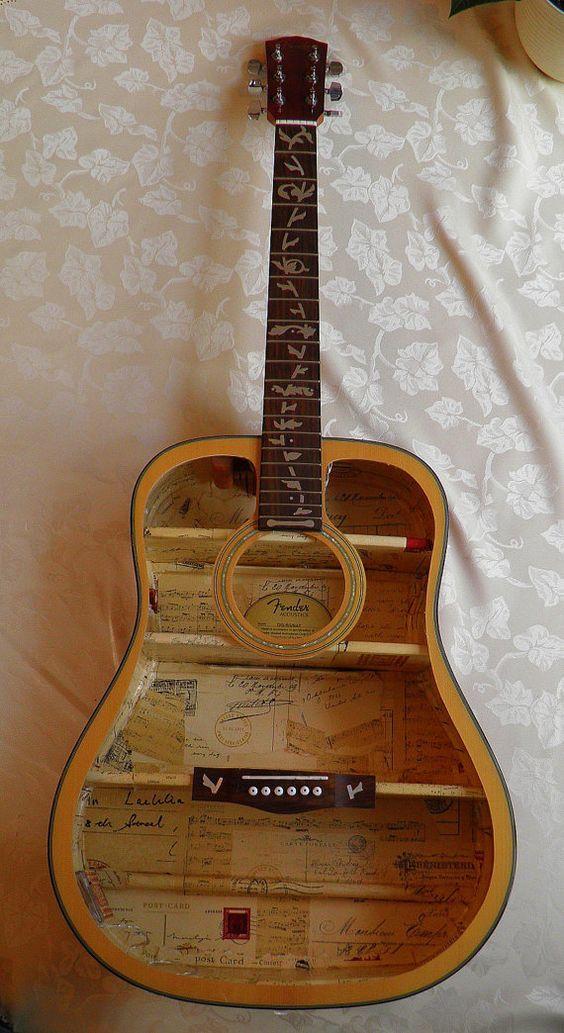 Astonishing repurposed guitar ideas repurposed guitars for Acoustic guitar decoration ideas