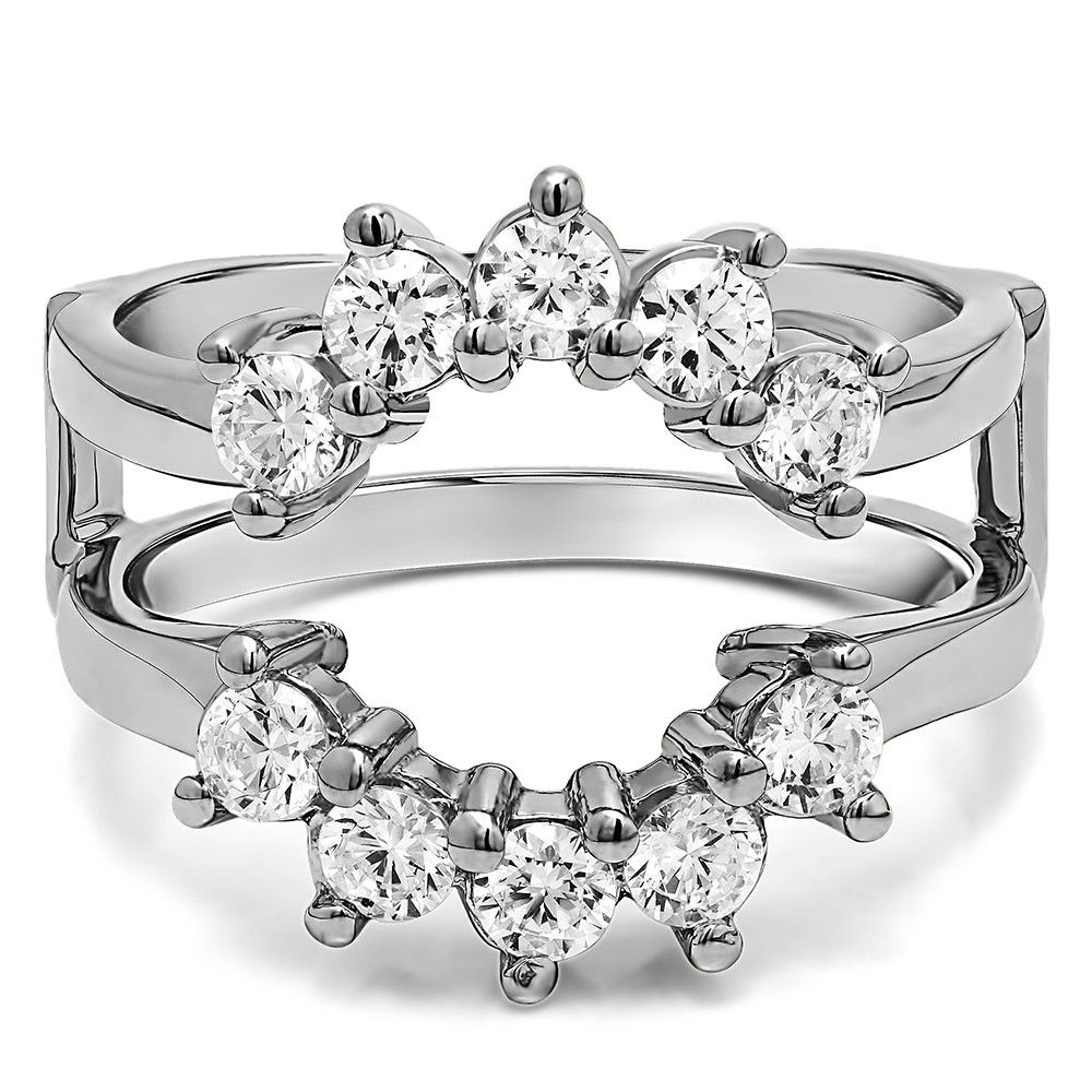 This wedding ring guard has 10 round, prong set stones