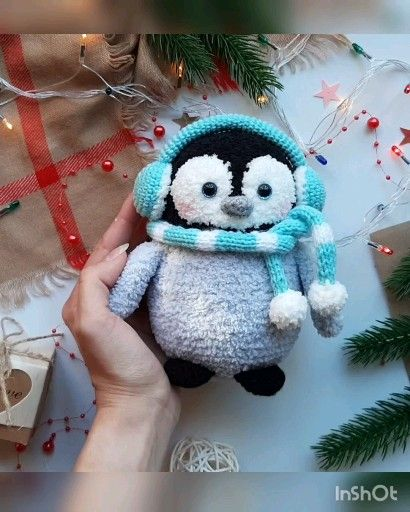 Photo of Crochet pattern penguin in scarf and headphones
