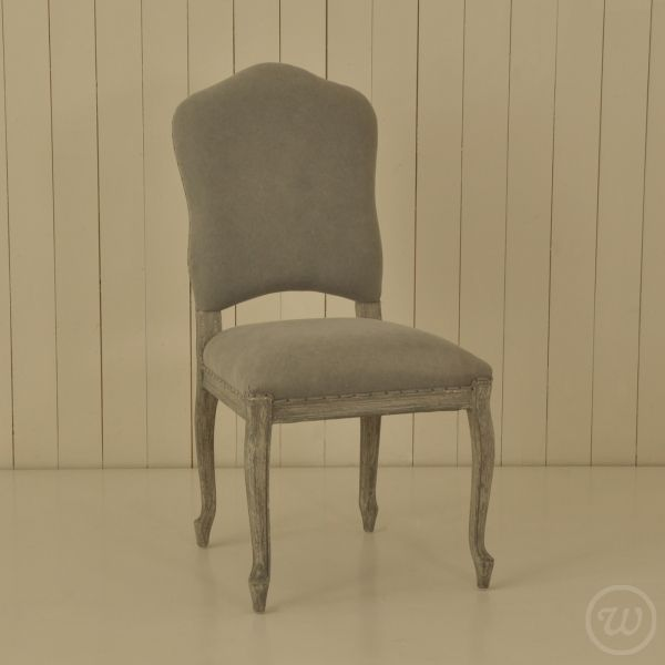 An Oak Dining Chair Upholstered In A Light Grey Fabric