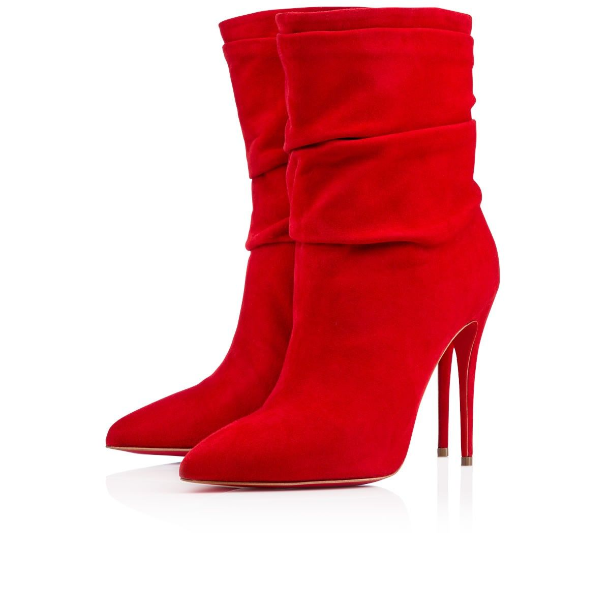 """Let your inner diva rise this season with """"Ishtar Booty"""" in luscious rouge de mars. Her exquisitely draped suede upper creates a sexy effect that is enhanced by her chic pointed toe and slender 100mm stiletto heel."""