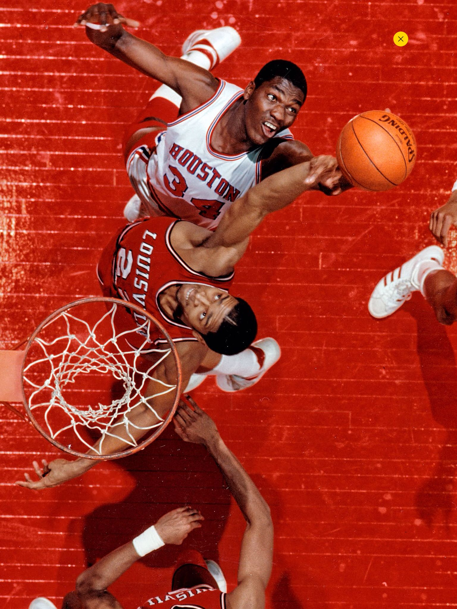Akeem Olajuwon 34 and Louisville s Rodney McCray 22 from the