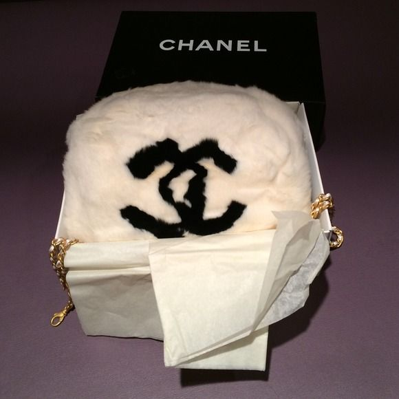 Chanel Muff % authentic No longer available so highly collectable. Purchased at Neiman Marcus and comes in original box. Chain is pristine and just has a few    fade spots on one side of zipper tab as pictured other than that has been maintained in a fur stable environment. No discolorations or staining.  authentic. CHANEL Accessories
