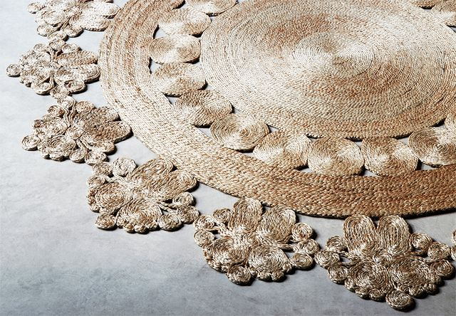I've developed a minor obsession with these handcrafted woven hemp rugs from Australian companyArmadillo & Co. Each circular rug, made under fairtrade work conditions and made from soft Bangladeshi hemp, is centered around a floral motif. They have so much potential to tie a room together -