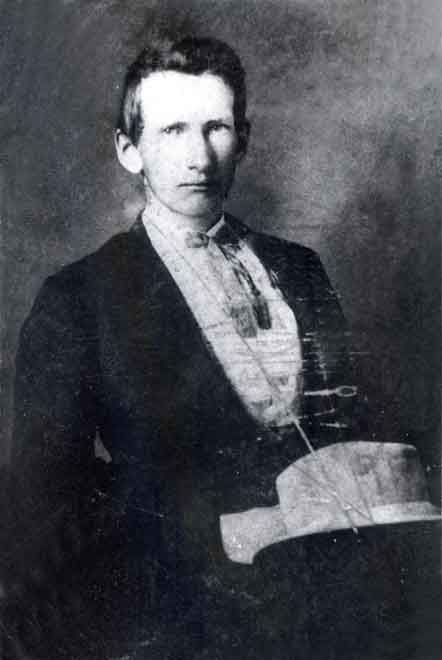 Photograph Of Frank James Sitting In Chair With Hat On Lap Taken