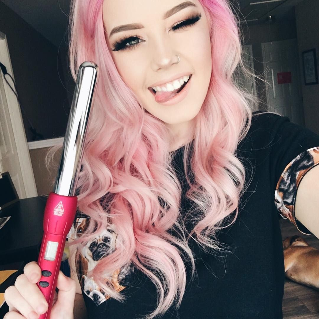 Hailie is spunky and dorky in pastel pink hair! We are in love with her color, curls and fresh face. She is using the NuMe 25mm magic wand to achieve her long and luscious curls #slayage
