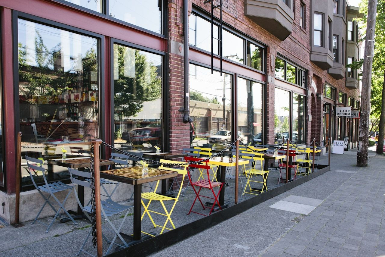 Outdoor Cafe Seating With Arrangement Of Seating Colors