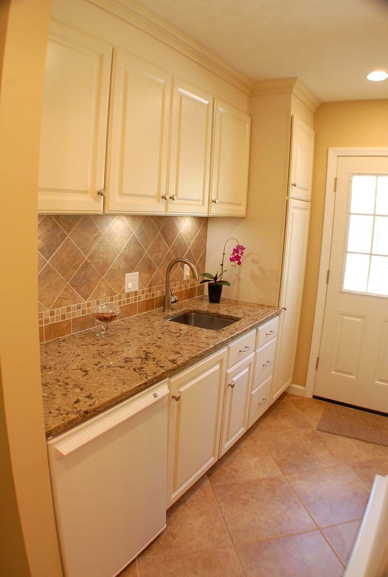 White Thermofoil Cabinets With Tile Backsplash Cambria