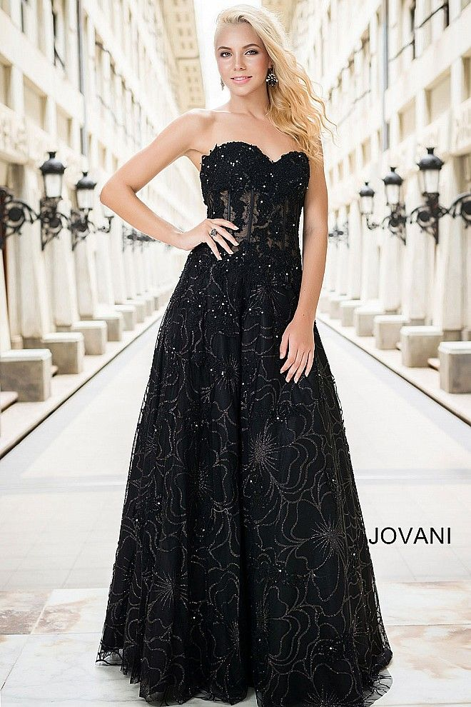 32a5fe5d53d Sweetheart neckline fully lined long black ball gown with a floral glitter  design and hot-fix crystal rhinestones features a concealed back zipper.