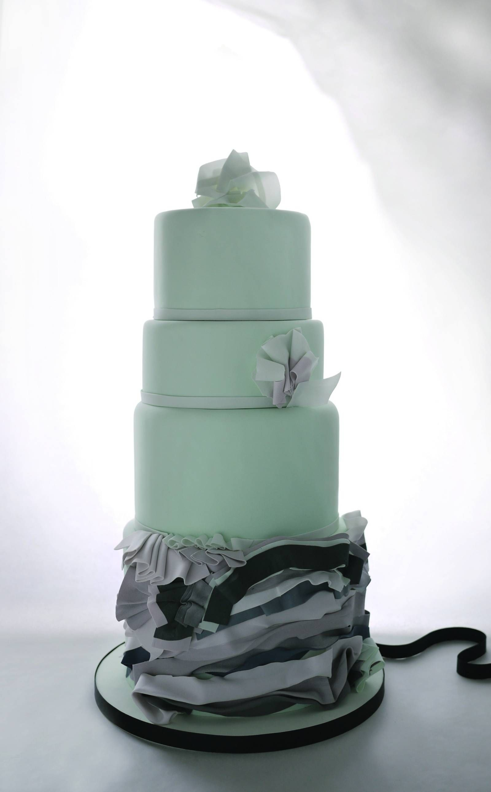Charm City Cakes' collection of colorful wedding cakes is inspired by art deco…