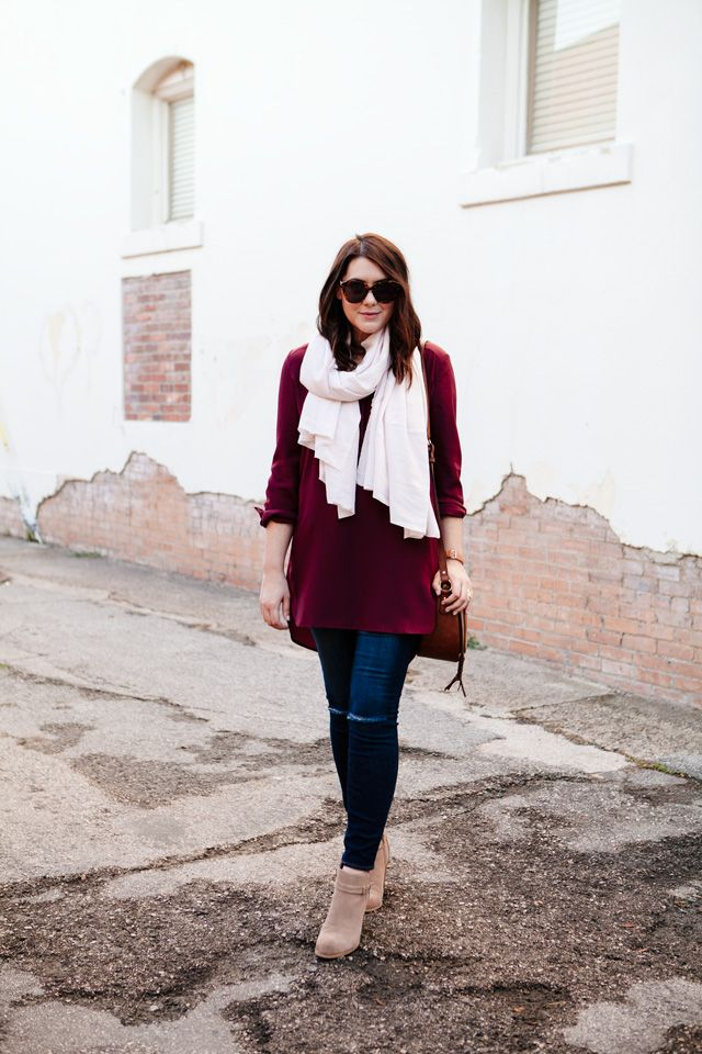Red blouse, distressed skinny jeans, suede taupe booties