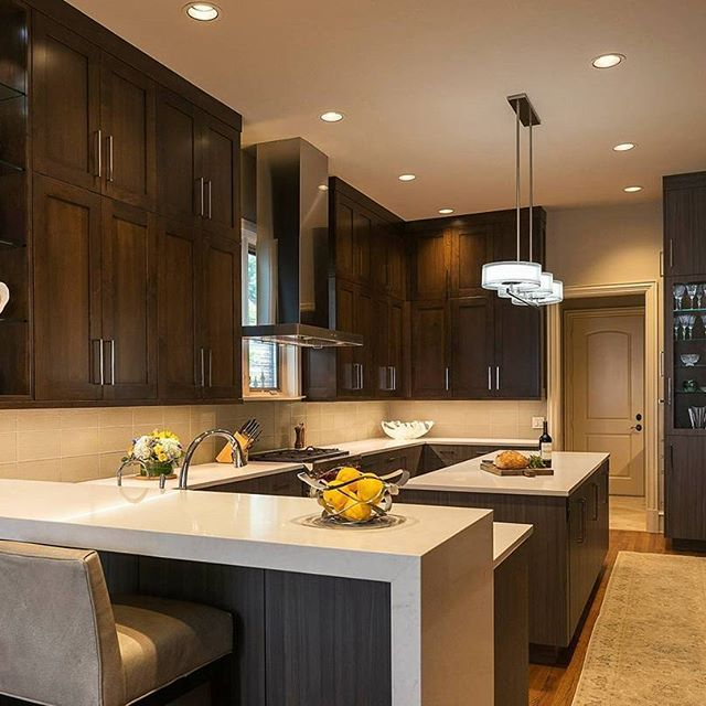 Can You Feel The Warmth Radiating From This Kitchen Shylo Preston Creates A Welcoming Space With Dark Cabinets And London Grey Counter Kitchen Home Decor Home