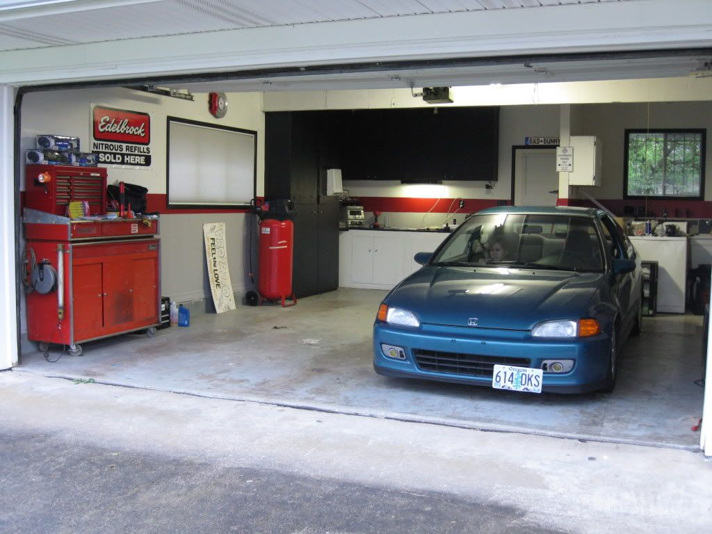 Home garage workshop google search home garage for Cool car garage ideas