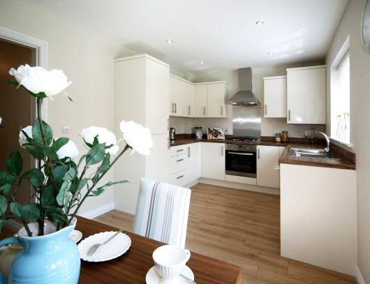 ivory kitchen, love the stripe on the dining chiars