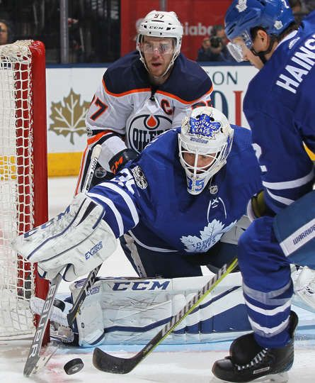 TORONTO, ON - DECEMBER 10: Curtis McEihinney #35 of the Toronto Maple Leafs stops a shot with Connor McDavid #97 of the Edmonton Oilers breathing over his shoulder during an NHL game at the Air Canada Centre on December 10, 2017 in Toronto, Ontario, Canada. The Maple Leafs defeated the Oilers 1-0. (Photo by Claus Andersen/Getty Images)