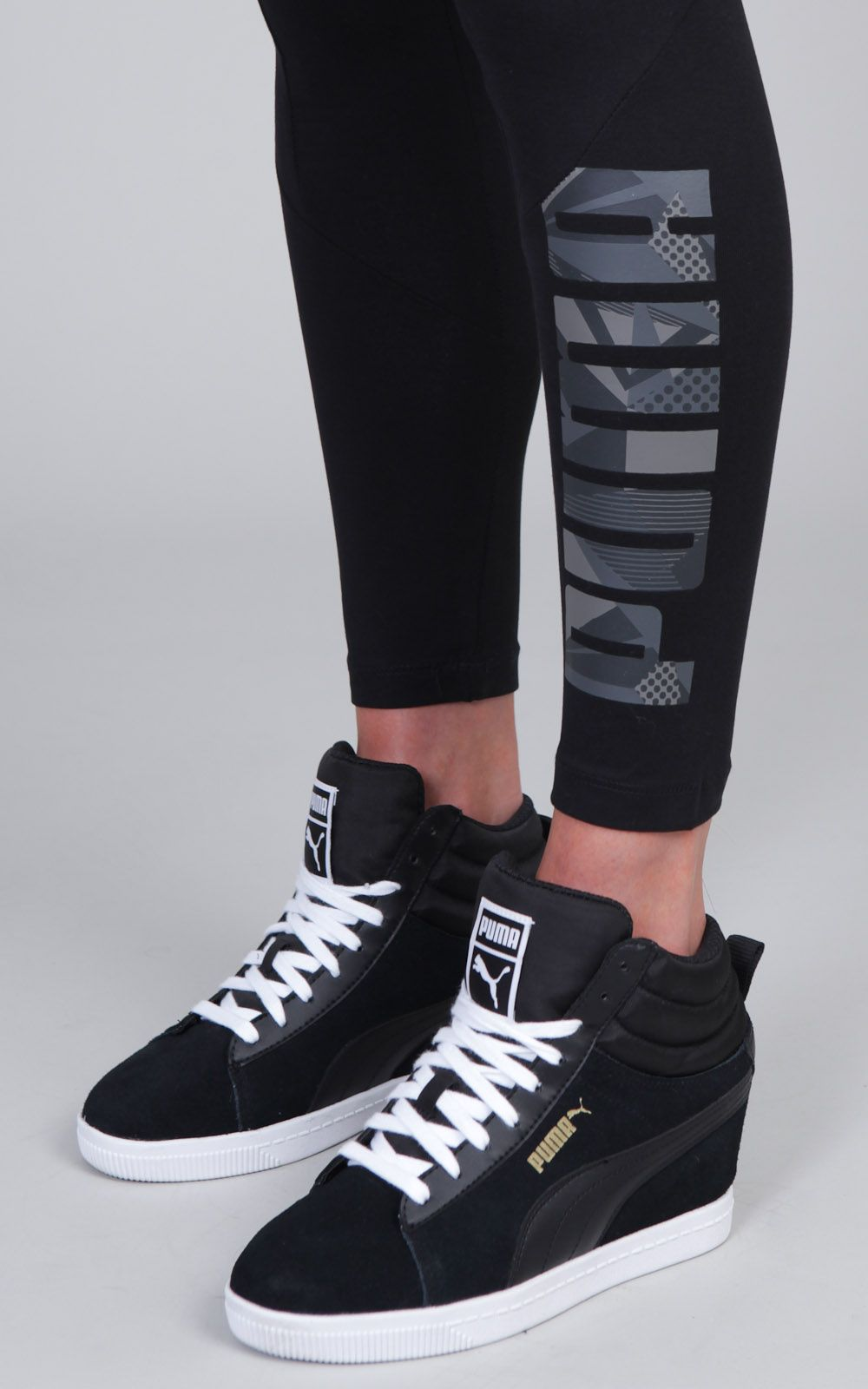 hot sale online 9a196 2fbb3 PUMA logo leggings paired with the PUMA Suede Classic sneaker wedge in  versatile black