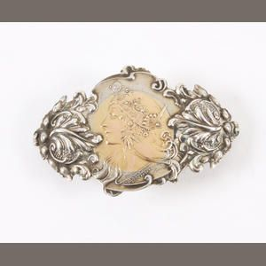 An American Art Nouveau two-colour brooch probably by Cowell & Hubbard With part maker's mark to the reverse, and 'Sterling & 14K' Estimate: £150 - 200 US$ 230 - 310 €190 - 250