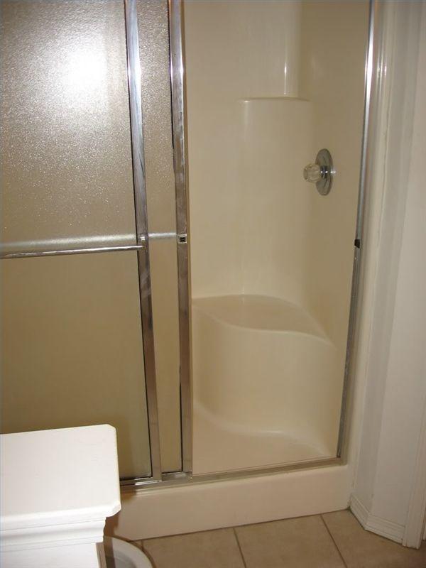 fiberglass shower stall installation video one piece corner stalls refinishing
