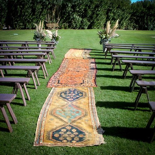 Use Persian Rugs As Aisle Runners At An Outdoor Wedding Ceremony