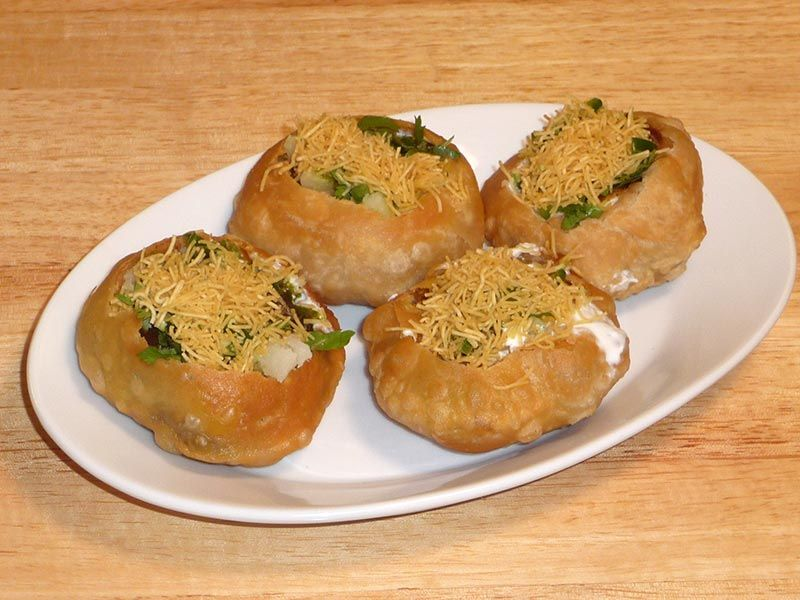 raj kachori is a spicy chaat bowl filled with delicious condiments it has refreshing flavors on hebbar s kitchen kachori id=21476