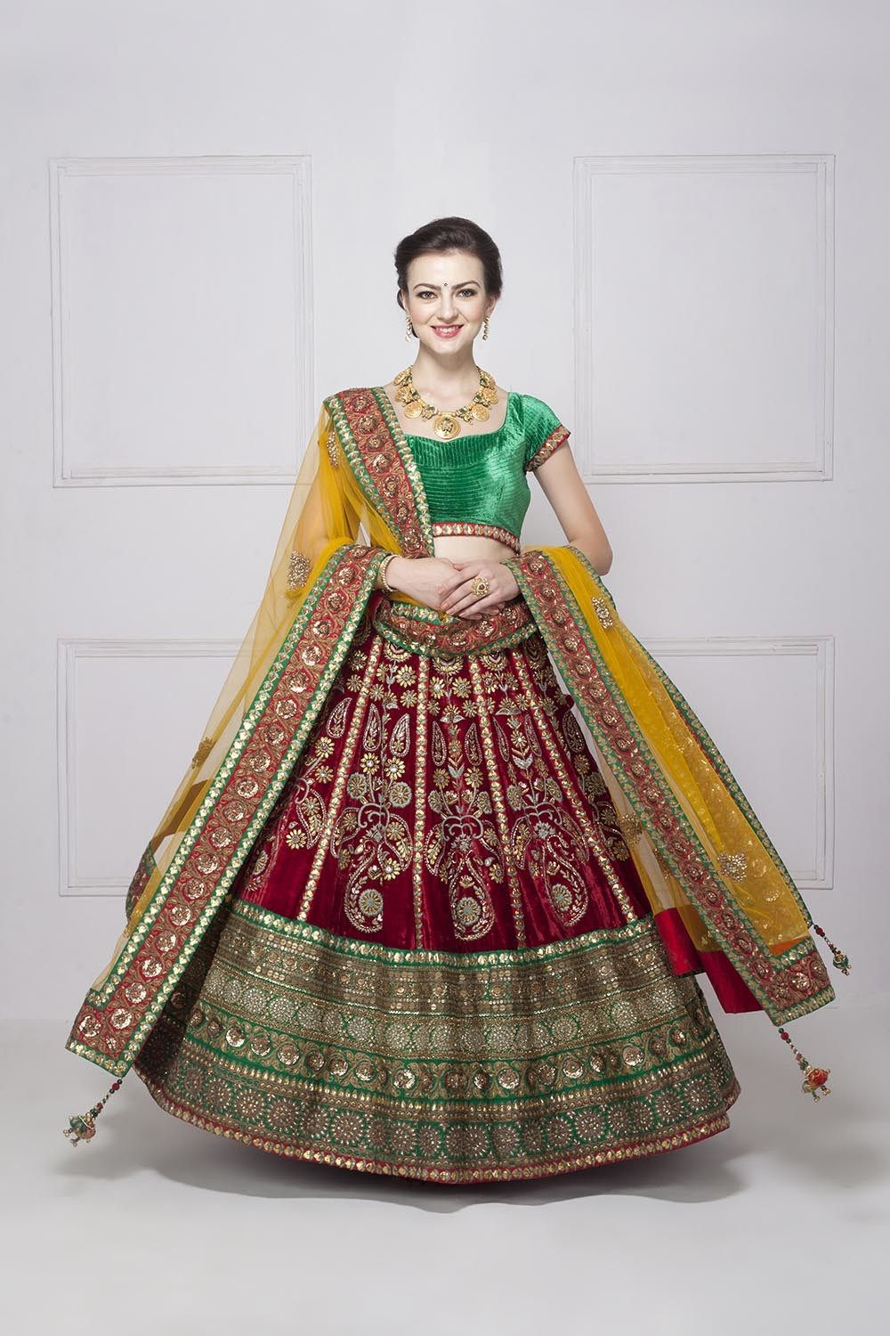 c4d73f3441 This gorgeous Frontier Raas red velvet wedding lehenga can be yours for  just under 18k rent. #Frugal2Fab