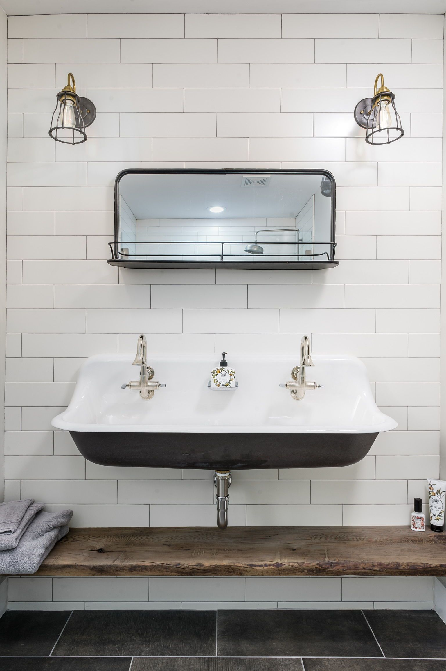 Stunning farmhouse bathroom with wood shelf and large sink ...