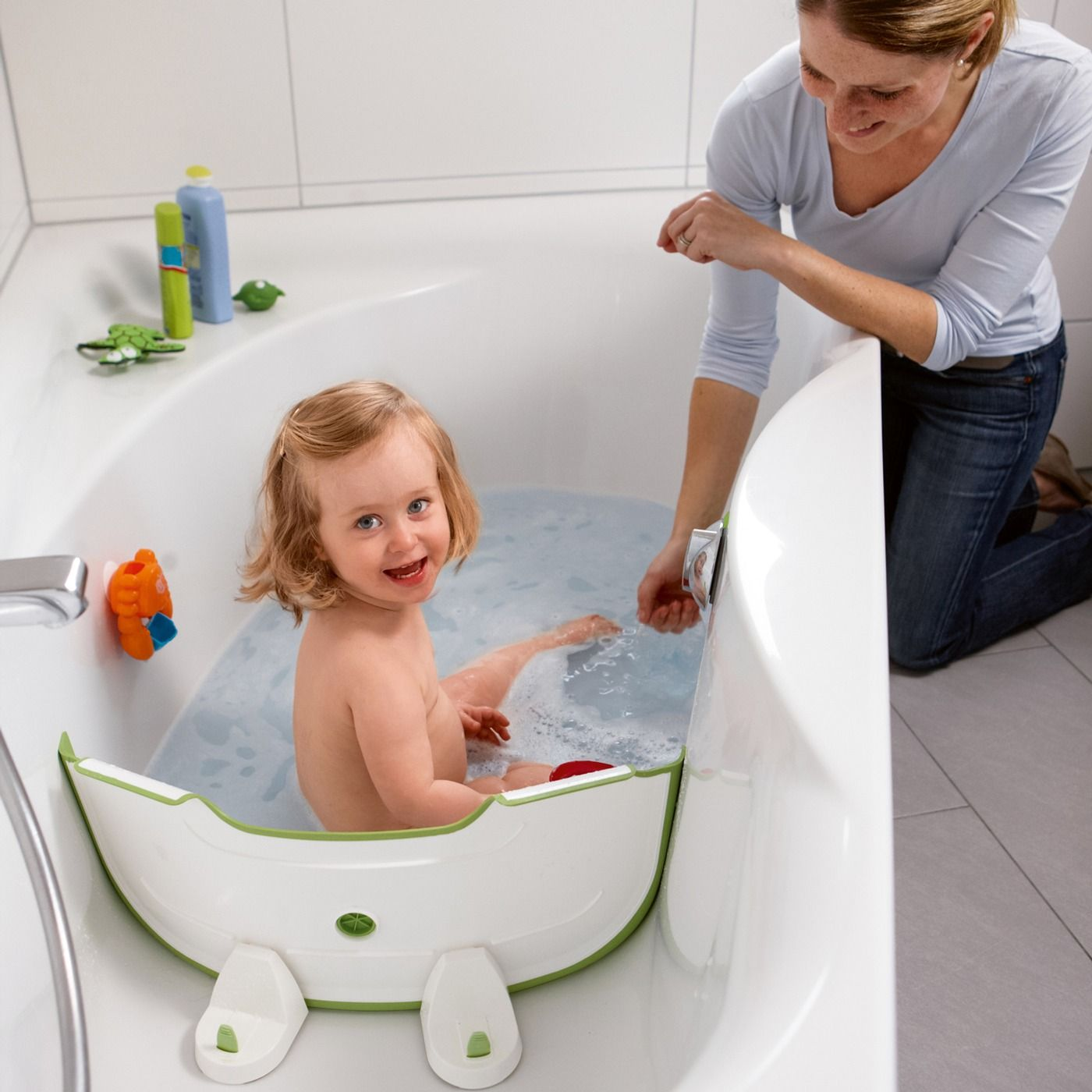 Flexible divider that can turn a regular bathtub into a baby ...