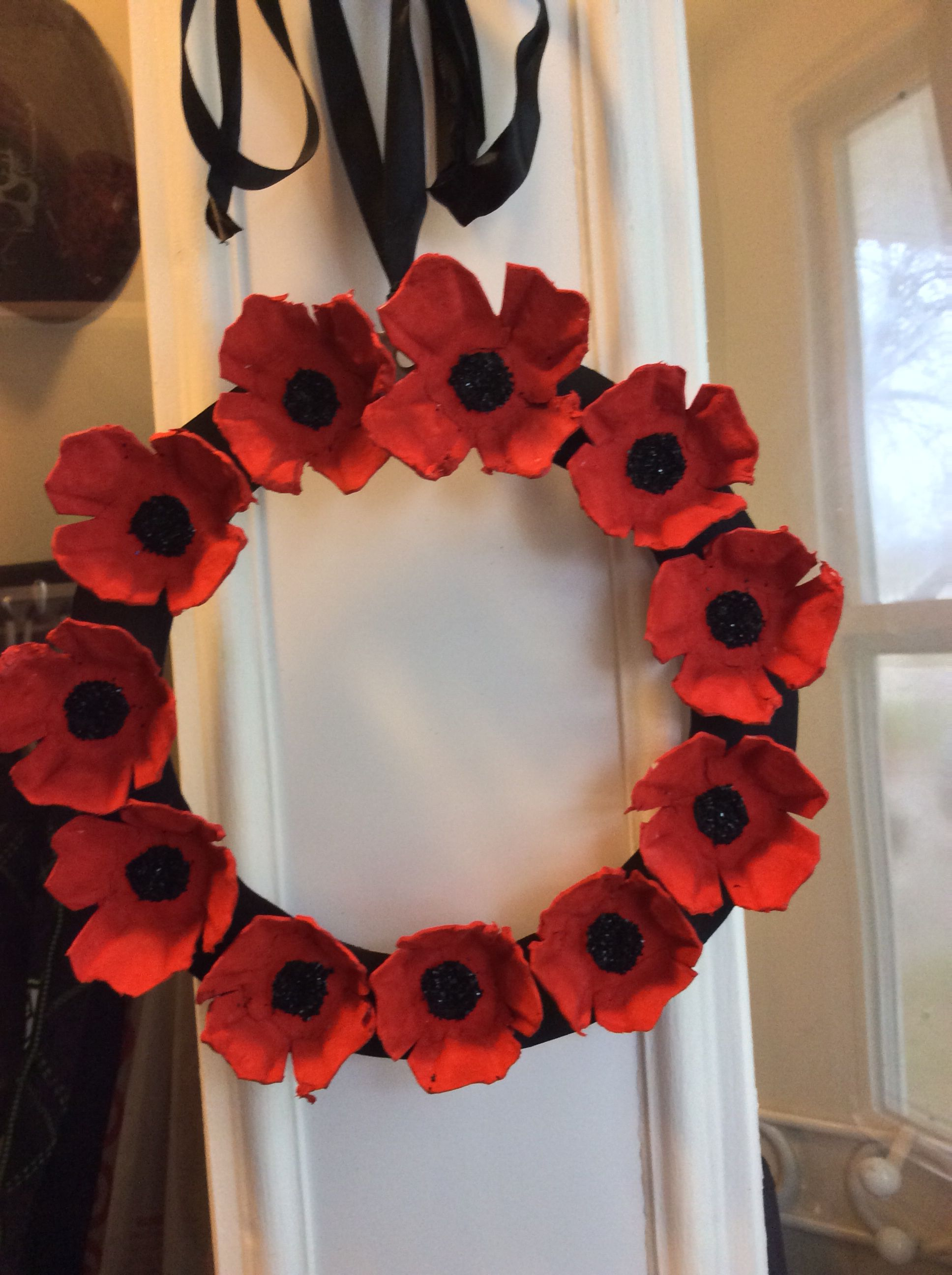 Egg carton poppy wreath., also see under wreaths