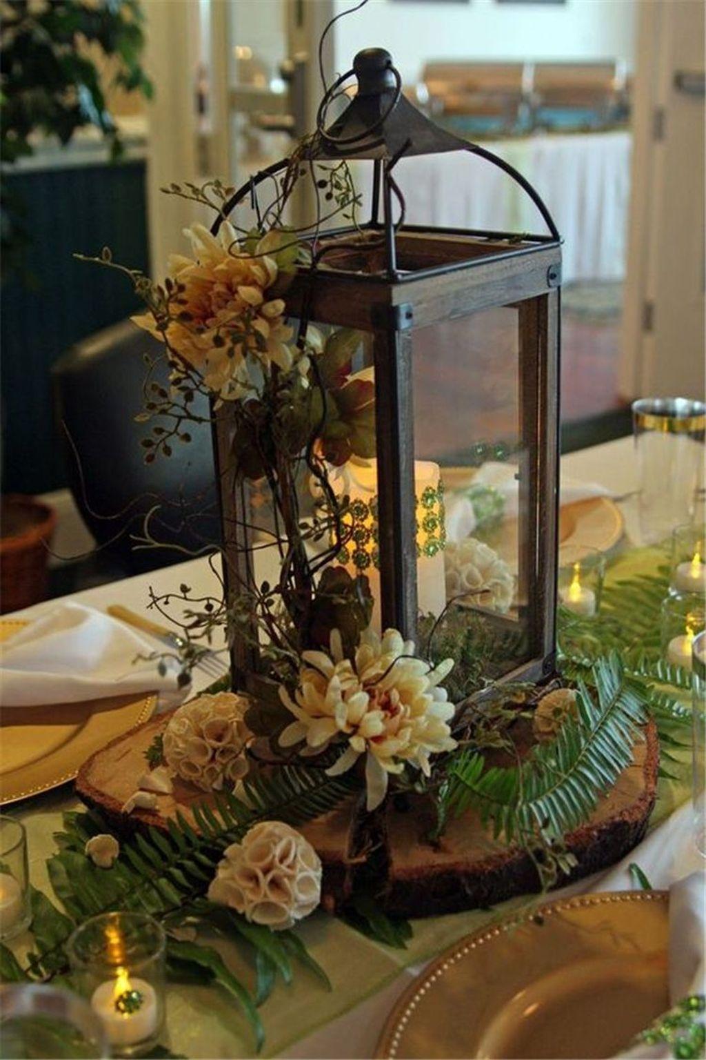 31 Gorgeous Winter Lantern Centerpieces Ideas Best For Dining Room Decor Lantern Centerpiece Wedding Table Flower Arrangements Wedding Decorations Centerpieces