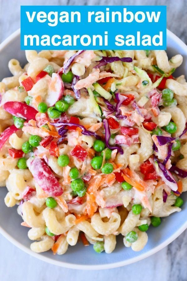 Rainbow Macaroni Salad is rich and creamy, packed with veggies and super easy to make! A great make-ahead side dish for entertaining, summer BBQs, Easter, Thanksgiving etc. Vegetarian, dairy-free, egg-free, gluten-free.