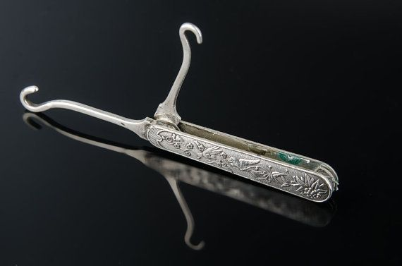 Victorian Gorham sterling double folding button hook.  size; 1/2 X 2 3/8 closed, 1 5/8 short hook, 1 3/4 long hook