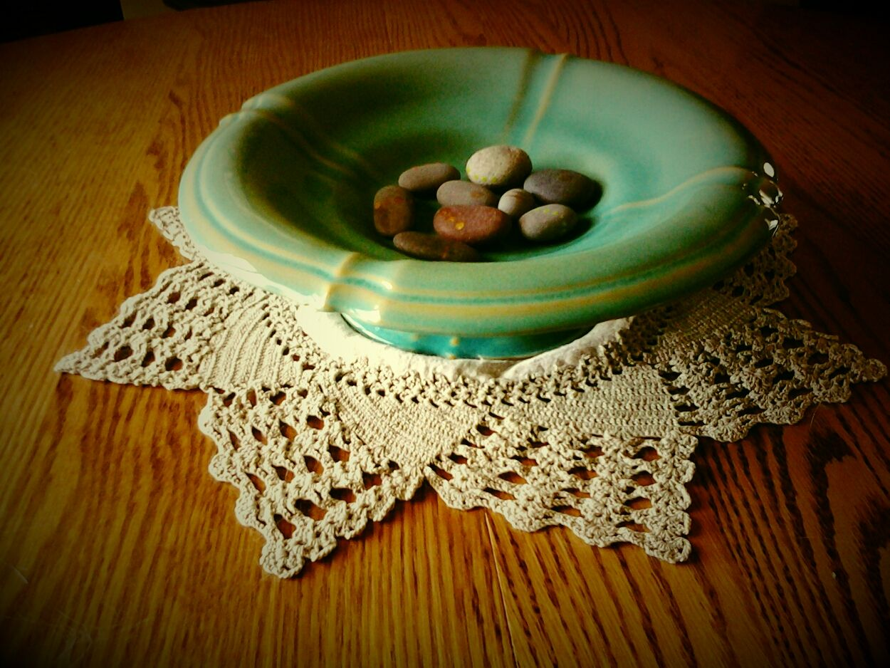 Morton & Clifton footed console compote bowl with rock collection on doily