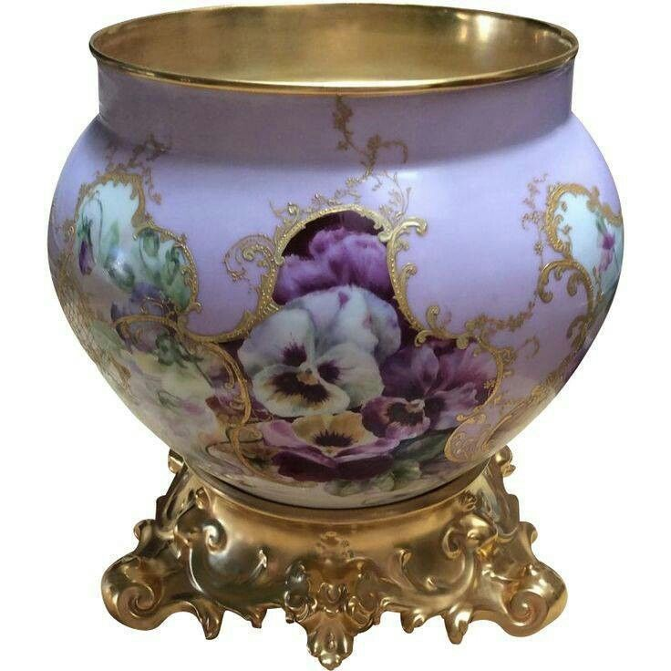 ornate bowl painted with pansies i m not sure if this would be used