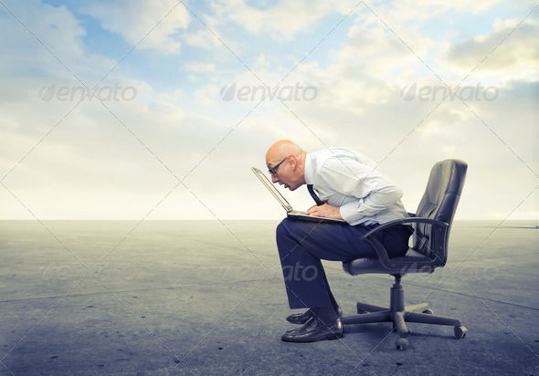Bald And Blind By Ollyi Bald Man Sitting On A Office Chair In A Wasteland Is Very Close To The Screen Of His Laptop Technology Photos Bald Man Man Sitting