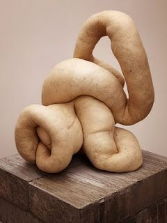 1. Sarah Lucas: Uses ready-made material like nylons, furniture etc. Her work usually tends to gravitate towards abstraction linked with ideas of gender and sexuality, humour and confrontation.