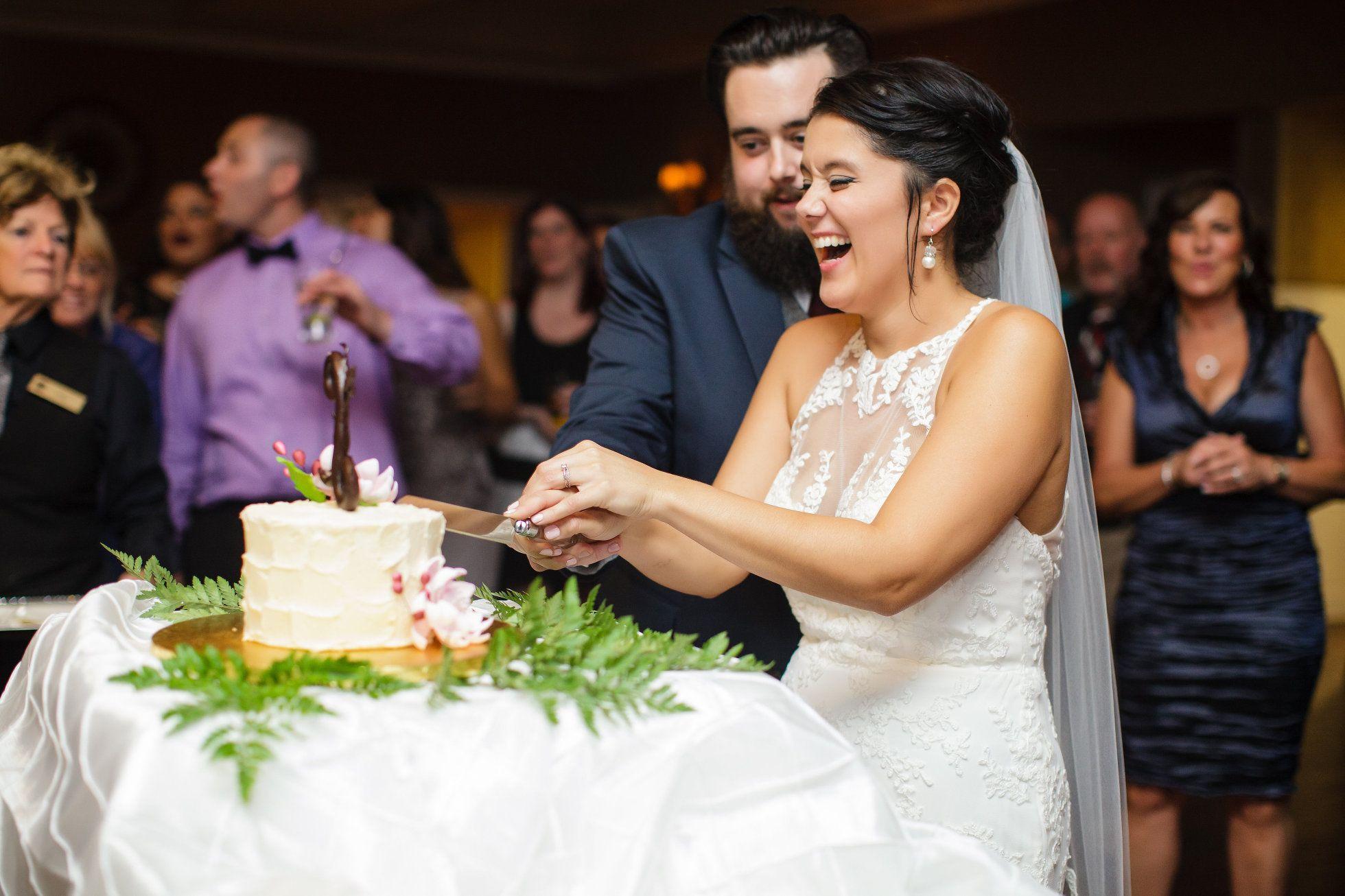 Bride And Groom Cutting Their Cake Shot By Rachel Pray Ashley
