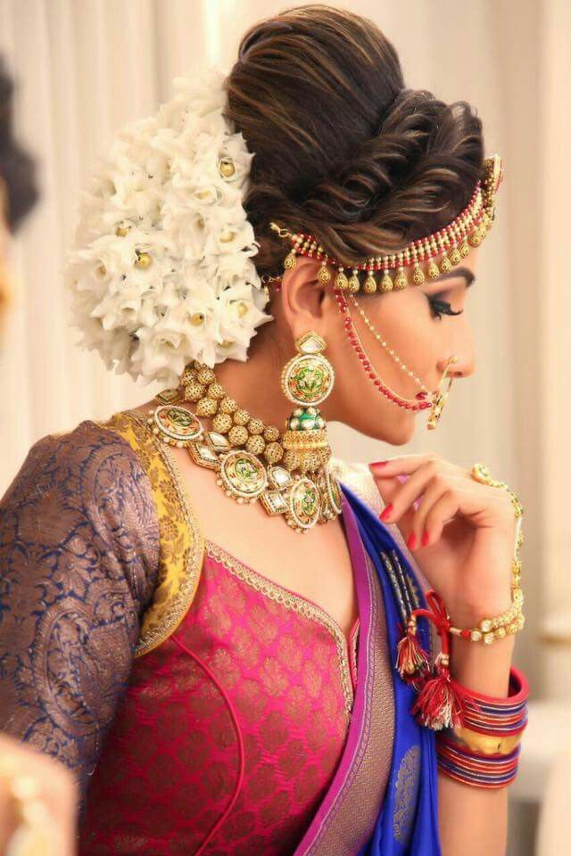 What A Beautiful Large Low Bun Covered With Jasmine Flowers Care However Should Be Taken Before A Bridal Hair Buns Hair Styles Bridal Hairstyle Indian Wedding