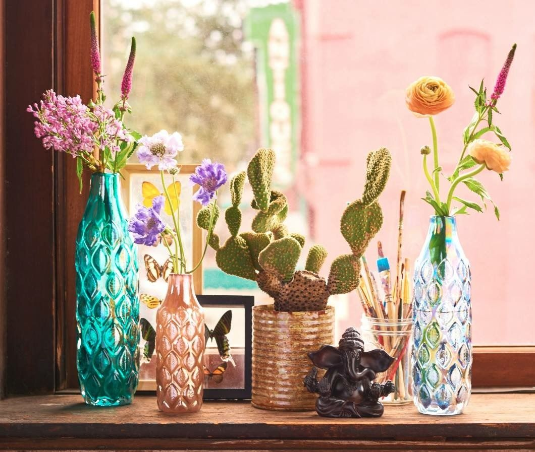 Earthbound trading company vases home sweet home pinterest large teal glass leaf vase is a large teal colored vase with leaf designs throughout it can be used to hold plants or displayed on its own reviewsmspy