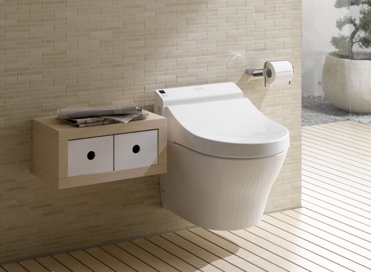 Toto Wallhung, rimless toilet with washlet seat. Clean