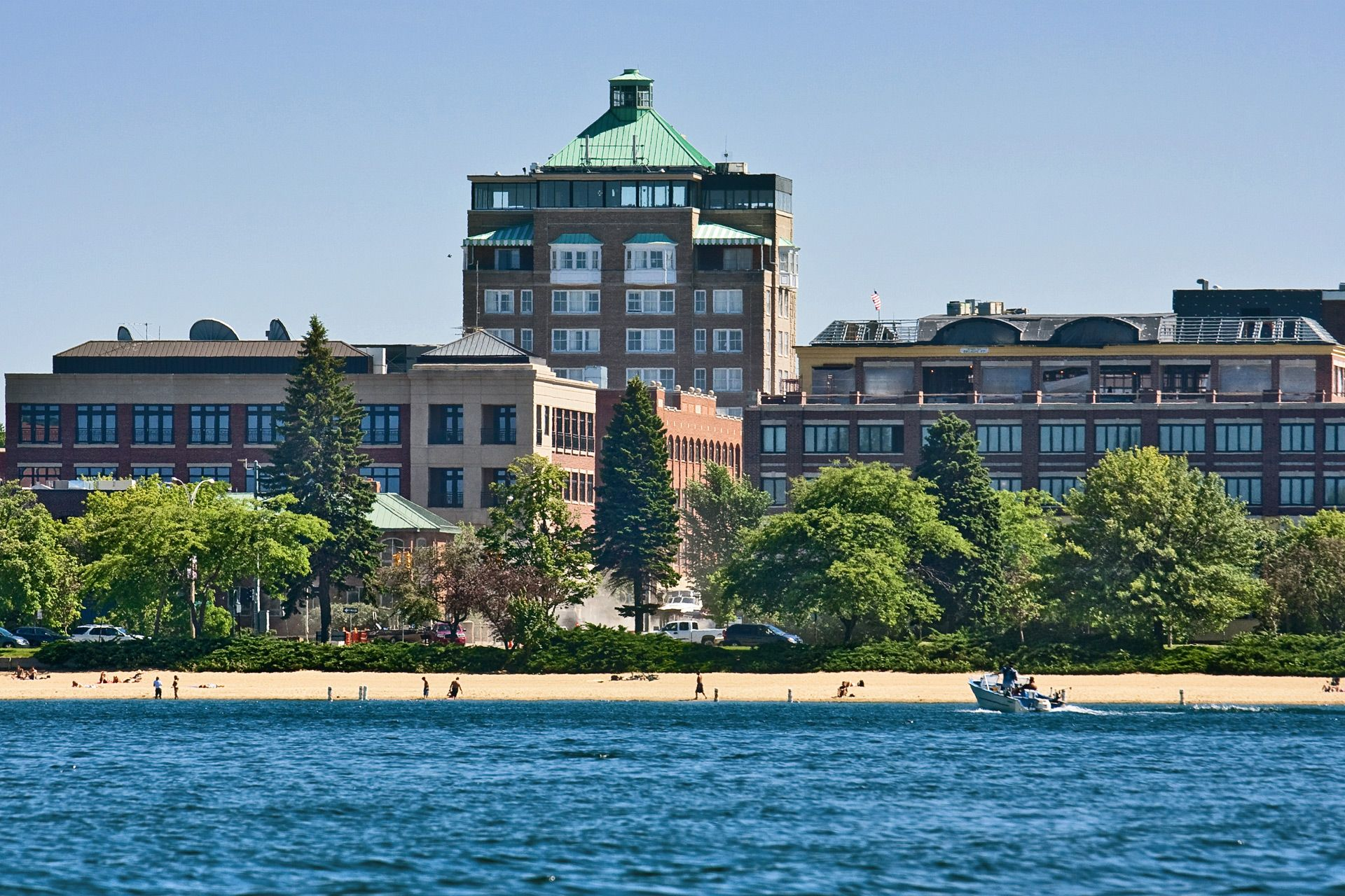 Traverse City Mi Park Place Hotel Has Welcomed Visitors Since 1873 The 10 Story Tower A Short Stroll From Bustling Fro Hotel Place Places Traverse City Mi