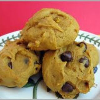 Scary Easy Pumpkin Chocolate Chip Cookies 1 spice cake mix 1 15 oz can pumpkin 1/2 bag dark chocolate chips  Bake at 350 for 10 minutes. Makes 2 dozen